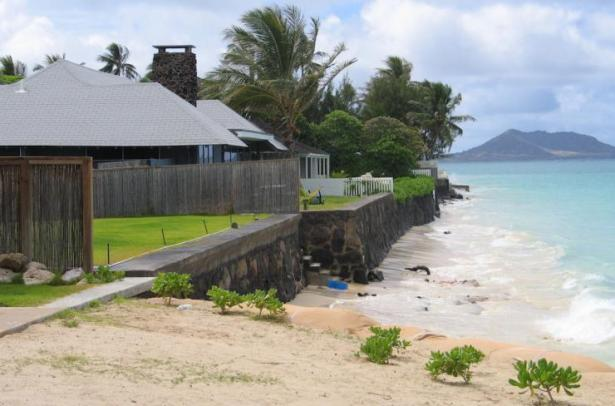 "<p>Fig. 3.&nbsp;Coastal erosion and ""hard armoring"" using sea walls has resulted in stretches of shoreline that have no beach, such as this location at Lanikai, O'ahu.</p><br />"