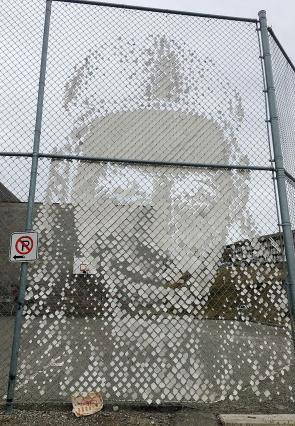 "<p>Fig. 3. This mural, representing the face of NBA star Kelly Olynyk, is made of pieces of recycled vinyl in the fence of Thompson Rivers University in British Columba, Canada.</p><br /> <p>To learn more about the art project, check out <a      href=""https://commons.wikimedia.org/wiki/File:2017-365-88_Basketball_Recycled_Art_(33331174390).jpg"">Wikimedia</a></p><br />"