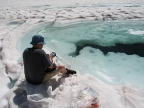 <p>Fig. 2. Dr. Craig Nelson samples under the ice to conduct research on microbial communities.</p>