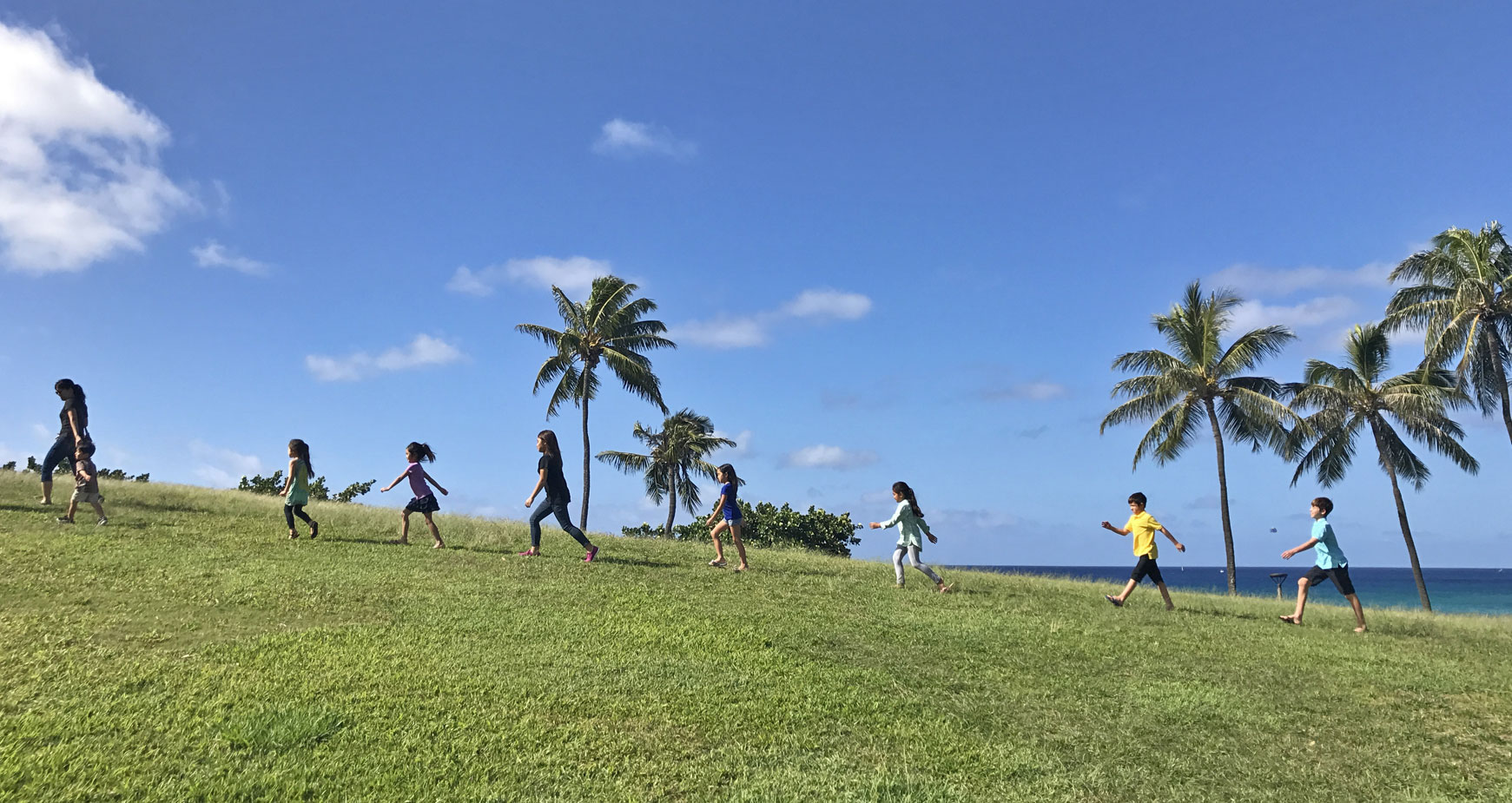 kids walking on a hill