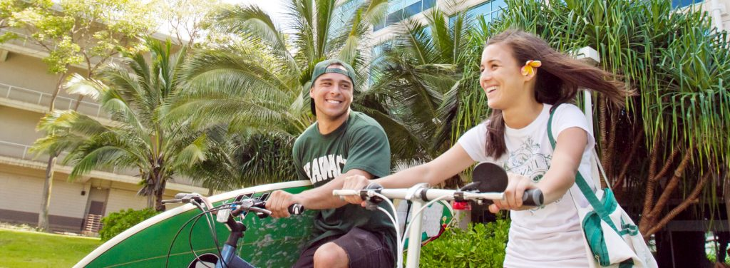 UH Mānoa students on bicycles