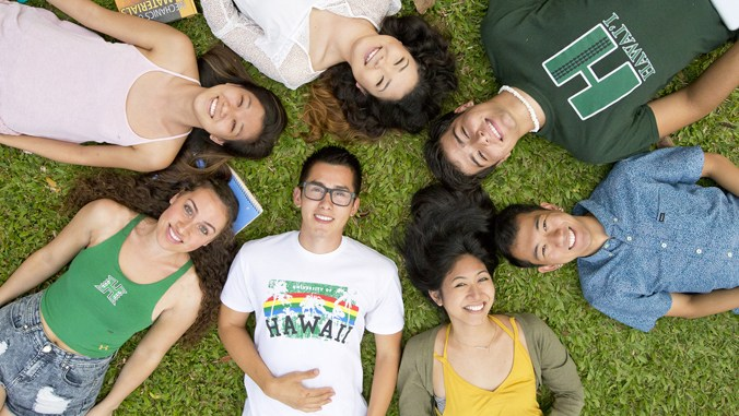 A group of students lying down