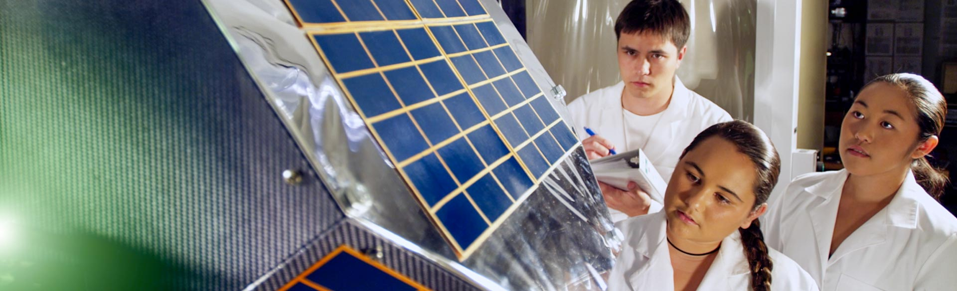 UH Manoa students working on a home-grown satellite