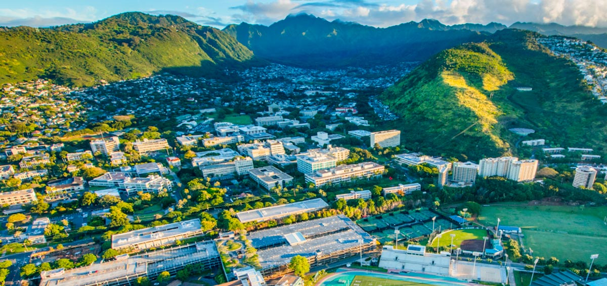 Aerial view of Manoa Valley in the early morning with the University of Hawaii at Manoa campus in the foreground